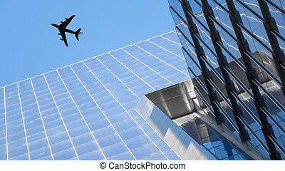 a plane flying over modern buildings of New York City