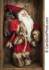 Santa Claus figure in a wooden box