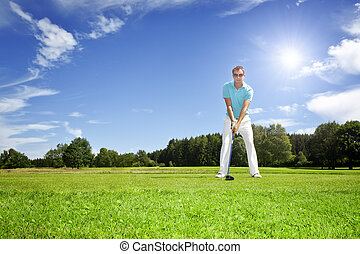 golf player - An image of a young male golf player