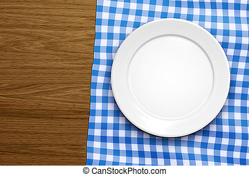 empty plate - An image of an empty plate on a wooden...