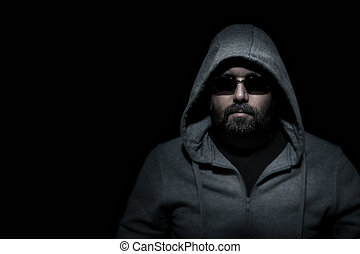 An image of an unrecognizable man in the dark