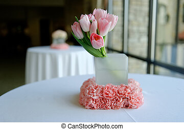 An image of beautiufl pink tulips wedding centerpiece