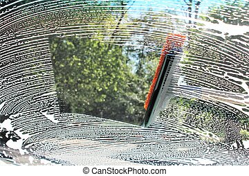 An image of cleaning a car window
