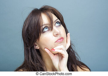 young brunette woman thinking