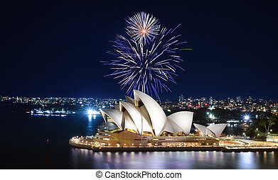An impressive display of fireworks light up the sky in blue and white over Sydney, Australia