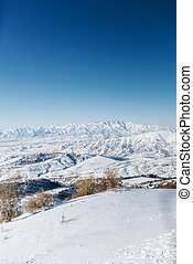 An incredibly beautiful panorama of the winter mountains of the Tien Shan in Uzbekistan