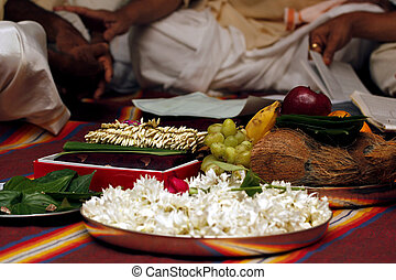 An indian engagement ceremony with tambula and other ...