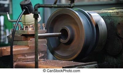 An industrial lathe working. Metal rod turning - mid shot