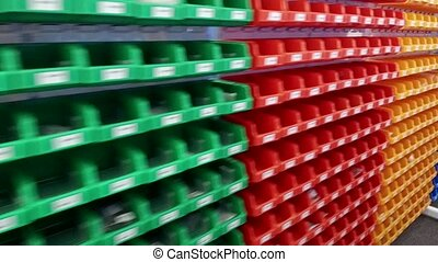 Large modern storehouse with some goods. Warehouse building with packed goods ready to ship - England, United Kingdom - 19th of September, 2019
