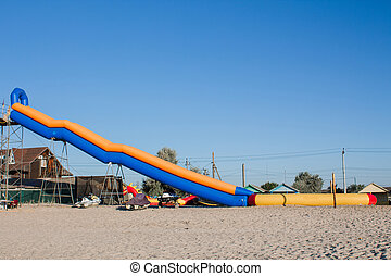 inflatable water slide on the beach
