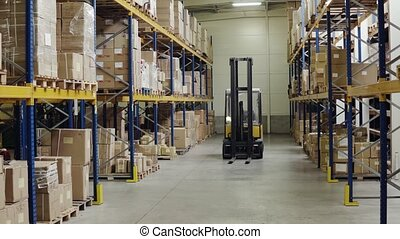 An interior of a warehouse with forklift.