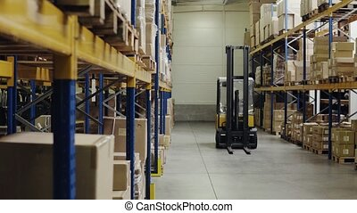 An interior of a warehouse with forklift. - An interior of a...
