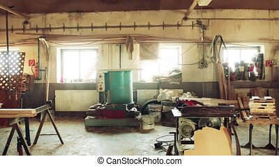 An interior of carpentry workshop. - An empty interior of a...