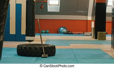 An interior of the gym - tire and hammer on the floor