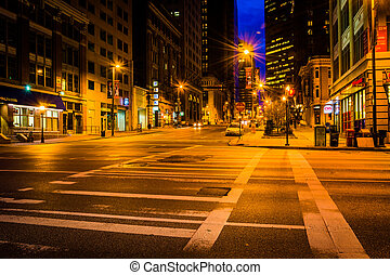 An intersection at night in Baltimore, Maryland.