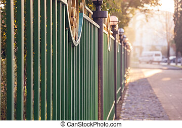 an iron fence enclosing the park of Poti city