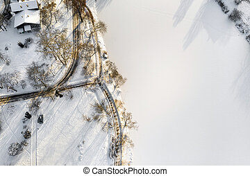 an island on a lake with a bridge in the Winter Loshitsky Park. Minsk, Belarus