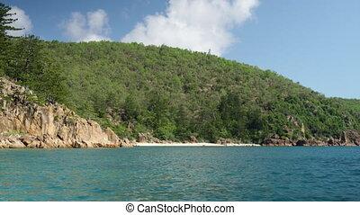 An island sitting on a vast sea - A wide idyllic shot of an...