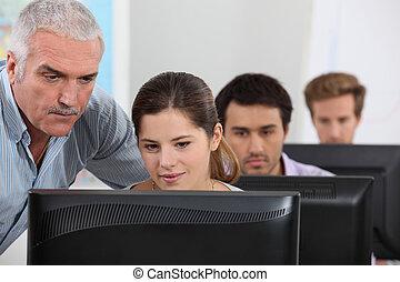 An IT teacher giving a class.