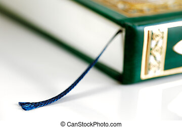 An macro image of the bookmark in the Quran. The Quran...