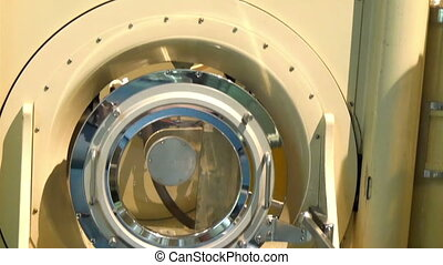 An MRI brain scanner usually seen in a hospital
