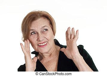 an nice elderly woman in a dress standing