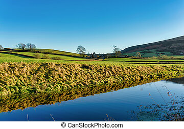 An oblique view of the Lancaster canal with Farleton Fell in...