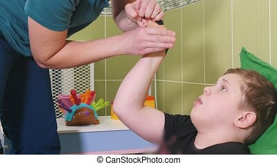 An occupation with child with cerebral palsy. Fine motor...