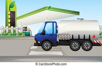 An oil tanker near a gasoline station
