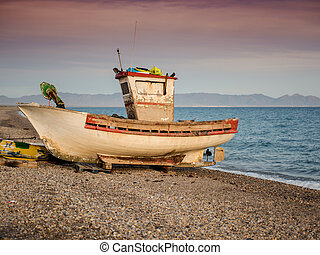 old abandoned boat on the seashore