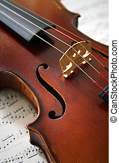 An old beautiful violin with notes