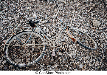 An old Bicycle abandoned on a shingle beach. Old bike with rust.