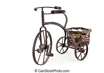 An old bike carrying a basket of nuts