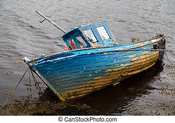 An old boat in a lake near Bundoran, County Donegal