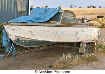 an old boat in front of a