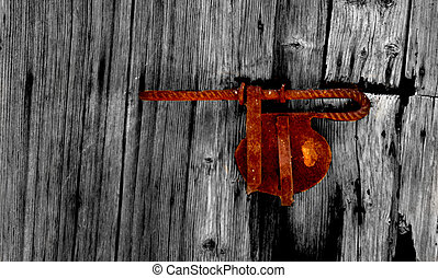 an old bolt of metal in a wood door