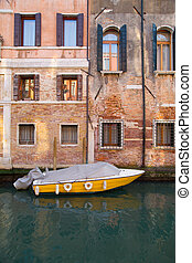 An old building and a boat in Venice