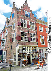 An old building with an antique shop. Netherlands, Delft