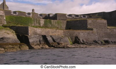 An old castle in Ireland - A shot from the ocean of an old...