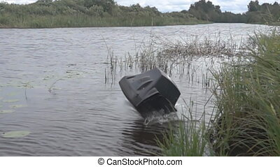 Old dirty telly falls into pond. This is real explosion. Decline television in traditional style concept. Laws of market and technological revolutions, new technologies. Super slow motion 1000 fps