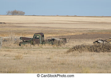 An old Farm truck abandoned in a field