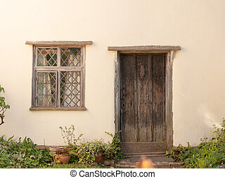 an old fashioned door and window of a cottage in england essex of the uk outside very clean and white