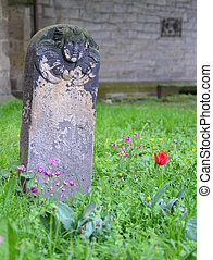 An old grave stone in the graveyard of church in Hannover, Germany