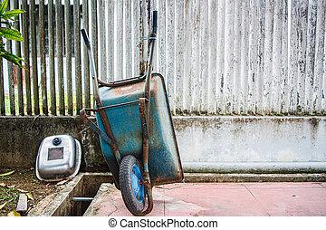 An Old Green Wheelbarrow in a Garden