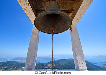 An old historic bell hanging above the island of Lefkada in Greece