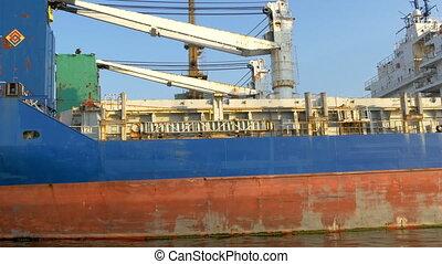 An old huge icebreaker ship on dock on the port