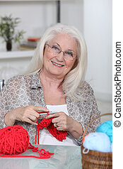 An old lady knitting.