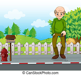 An old man at the road with a cane