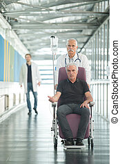 an old man in a wheelchair in hospital