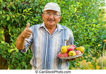 an old man with a tray of fruit